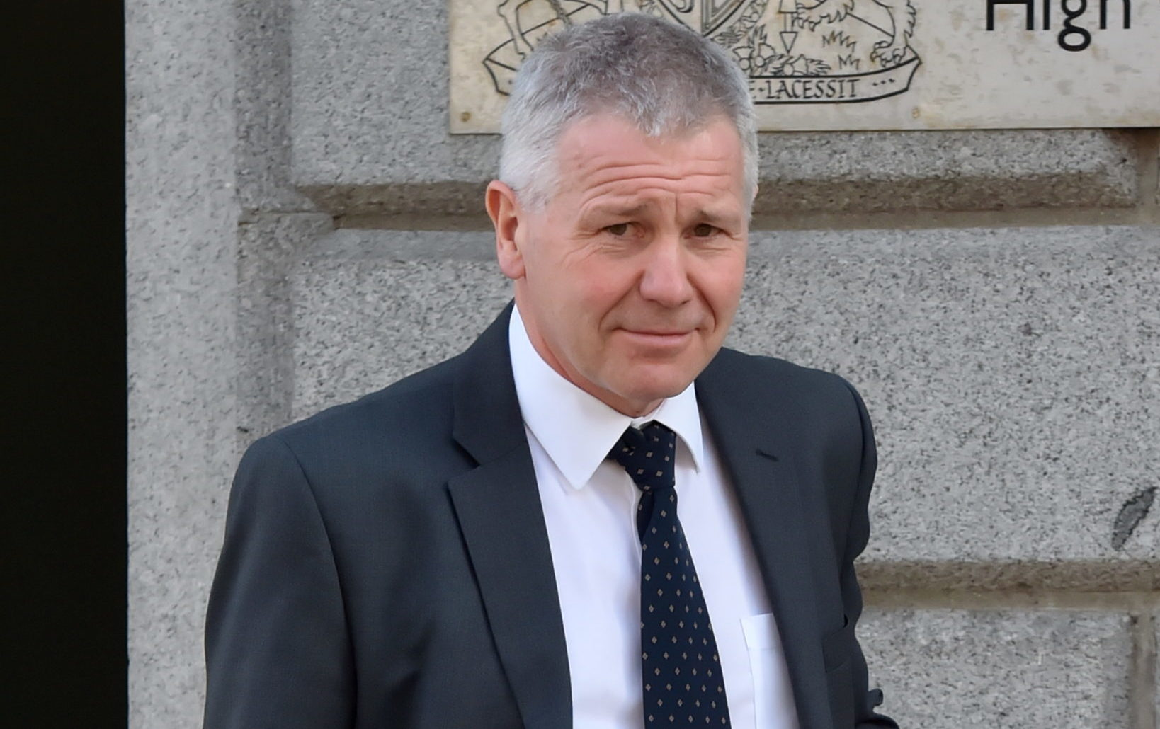 Gordon Duthie, forensic medical examiner, leaving the High Court in Aberdeen.