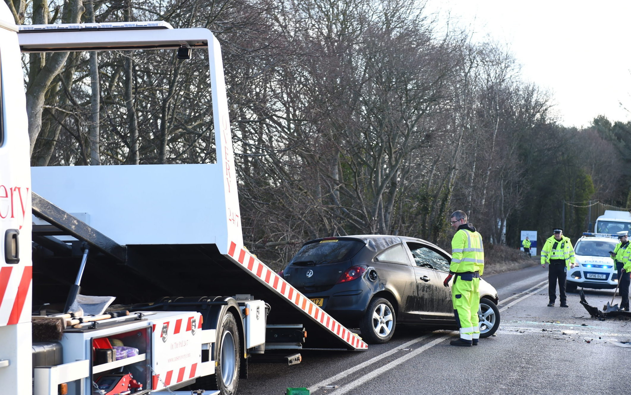 A recovery vehicle pictured removing the damaged Vauxhall Corsa on South Deeside Road.  Picture by Paul Glendell.