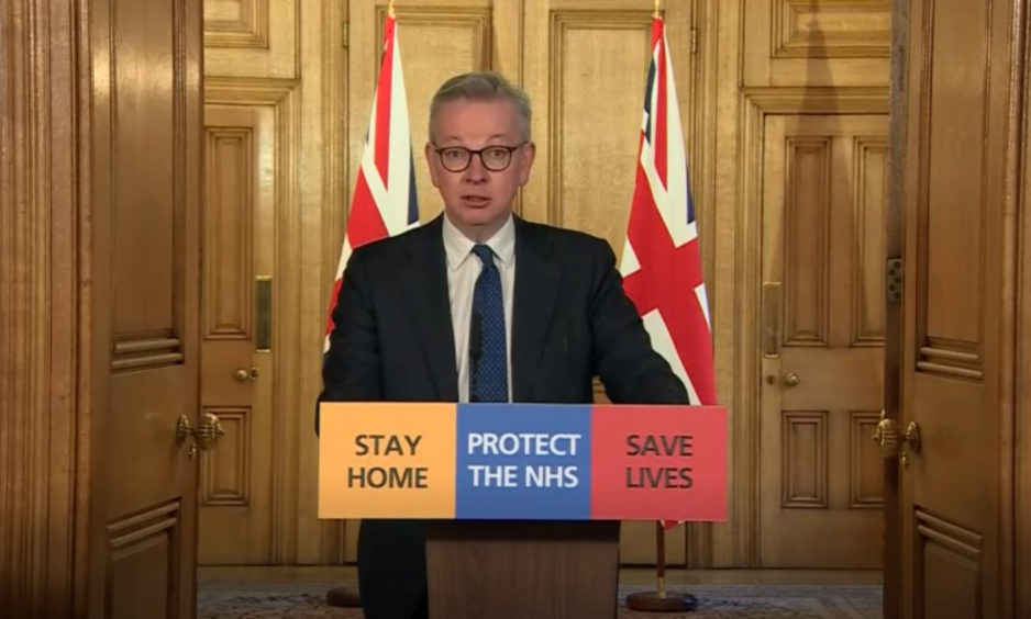 Michael Gove answering questions from the media via a video link during a media briefing in Downing Street.