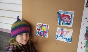 Meredith Clarke, 5, creating her tiles, inspired by Dunnet Bay and the surfers.