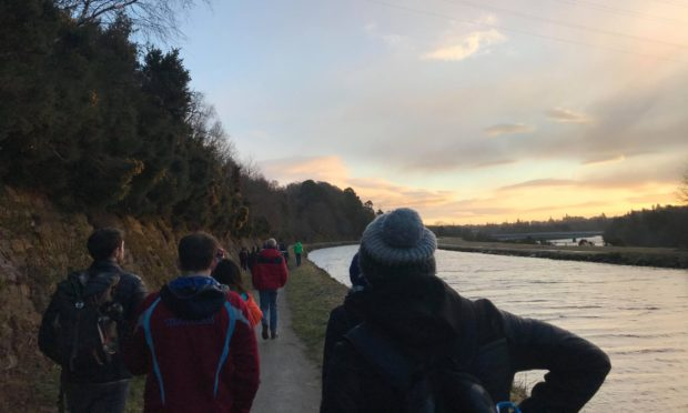 Around 55 gathered to undertake the walk along the Caledonian Canal. Photo by Megan Grant