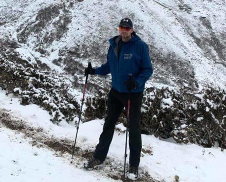 Lee Chapman pictured climbing Mount Everest.