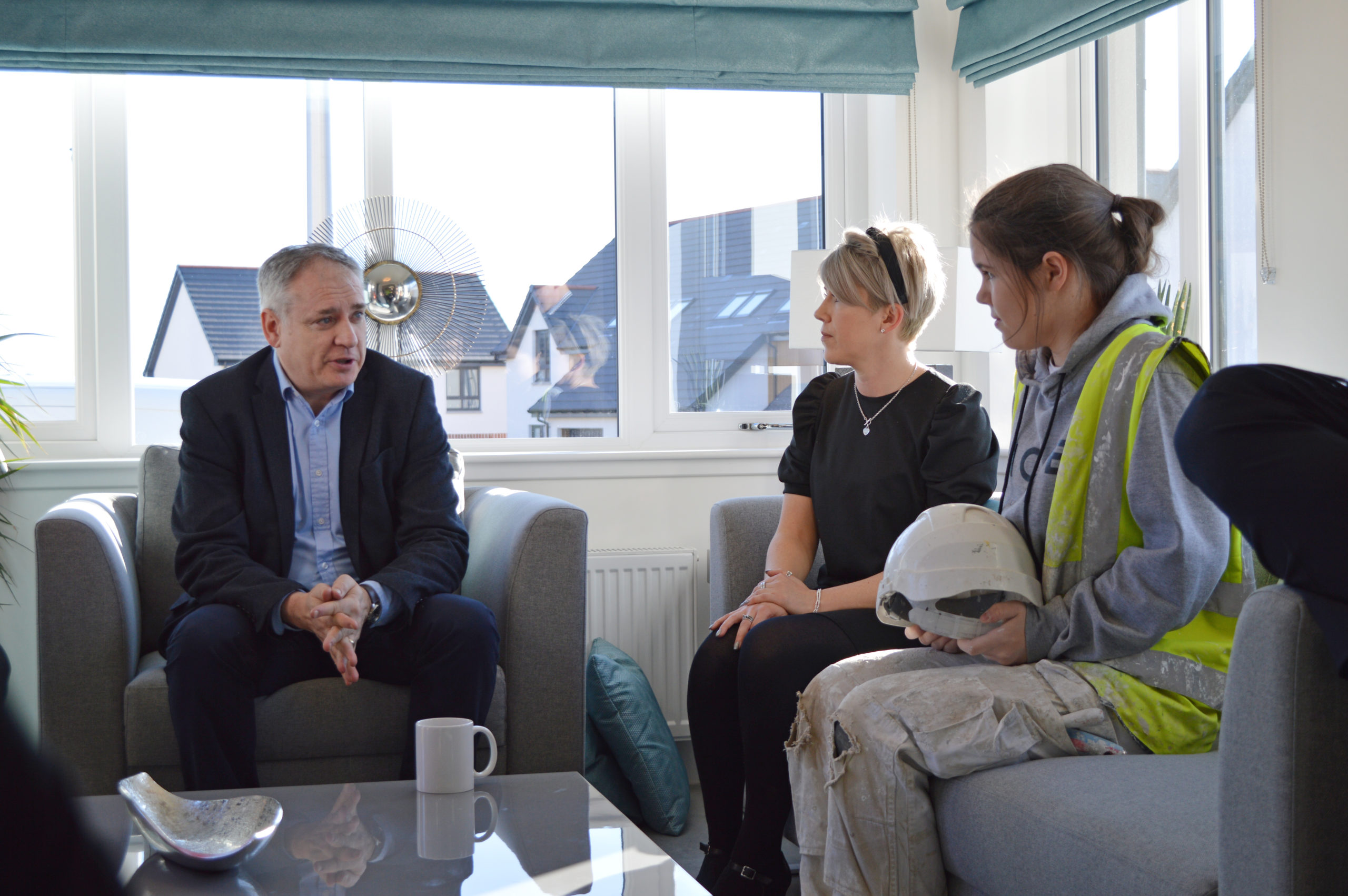 Scottish Government minister Richard Lochhead with Springfield's senior HR advisor Diane Kemp and apprentice painter Sophia Massie.