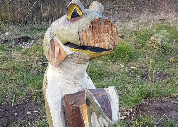 """Mr Frog, a kindly Portlethen wooden sculpture, has had his """"arms hacked off"""" and """"face gouged out"""" in a vicious and, seemingly, unprovoked attack."""