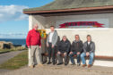 Campaigners in Hopeman are celebrating the installation of a lifesaving defibrillator at the village's harbour. Pictured: Hopeman Community Association chairman, Dennis Slater, Blair Tulloch, architect from Tulloch of Cummingston, volunteer Jack Burke, electrical fitter Donald Beattie, community association vice-chairman Murray Easton.