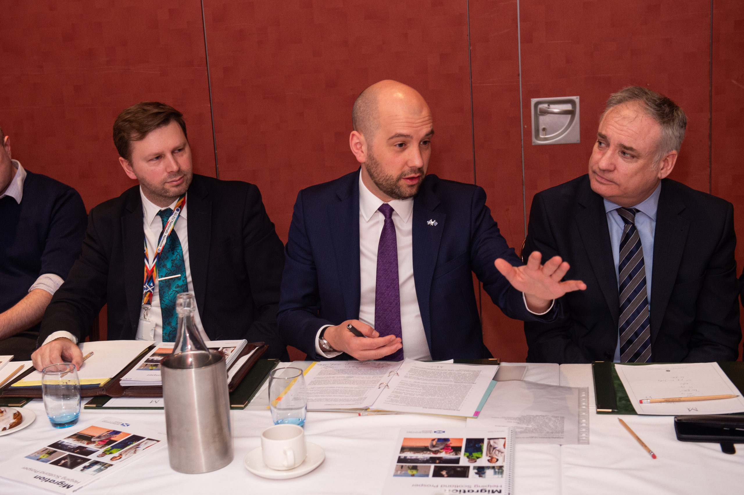 Scottish Government minister Ben Macpherson, pictured centre, addresses the Elgin meeting.  Picture by Jason Hedges.