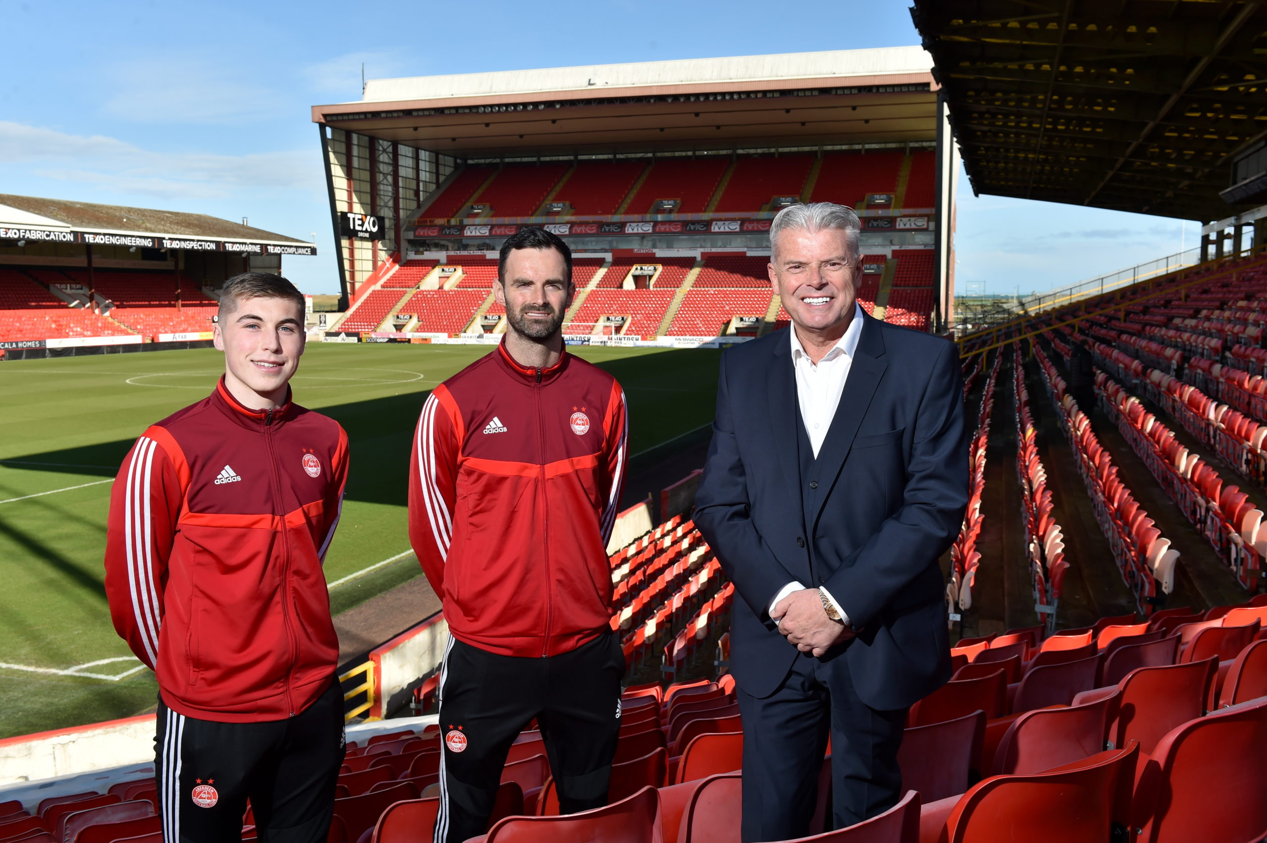 Aberdeen chairman Dave Cormack, club captain Joe Lewis and midfielder Dean Campbell at the launch of the club's new season-ticket initiative. Picture by Kenny Elrick