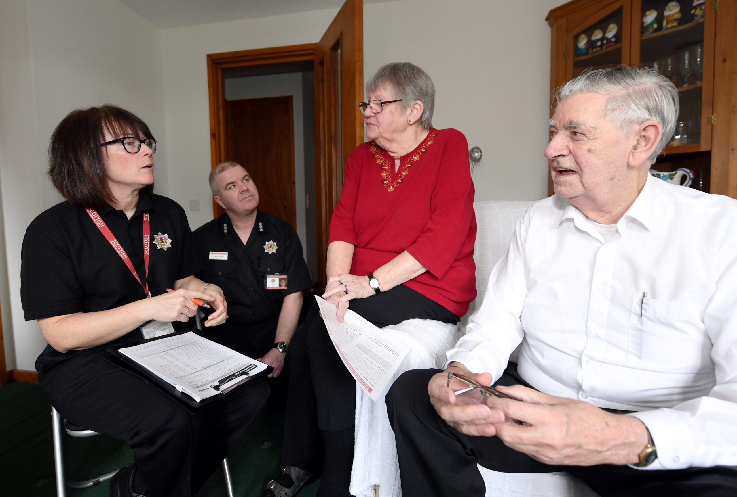 Community safety advocate Jennifer Forsyth along with station commander Craig Shand, visited new residents at Hanover Court, Inverurie, Joan and George Rae to offer advice.      Picture by Kami Thomson