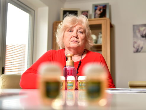 Dorothy Elder with hand sanitiser brought back from the states. Picture by Scott Baxter