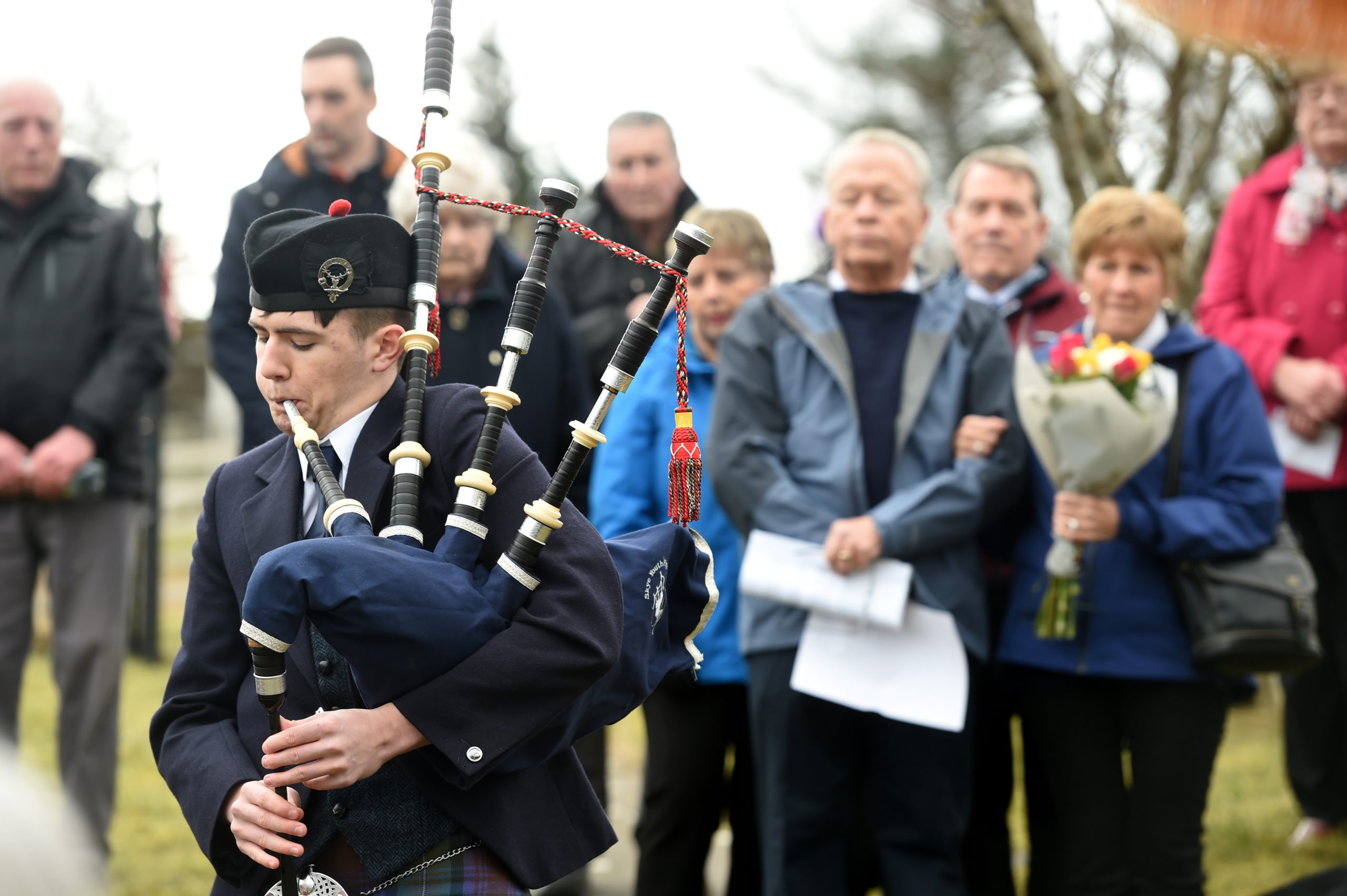 A memorial service took place yesterday at the Staffin War Memorial on Skye in memory of the nine American airmen who died when their aircraft crashed in mist on Beinn Edra 75 years ago to the day. Doug Overfield with his wife Barb from the USA during the service. Picture by Sandy McCook