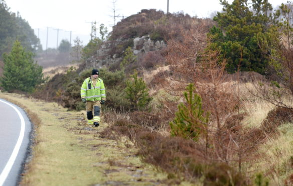 Members of the fire service searching the route between Kyleakin and Broadford on Tuesday.