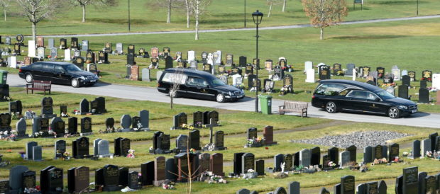 The cortege arrives at the cemetary for the commital.