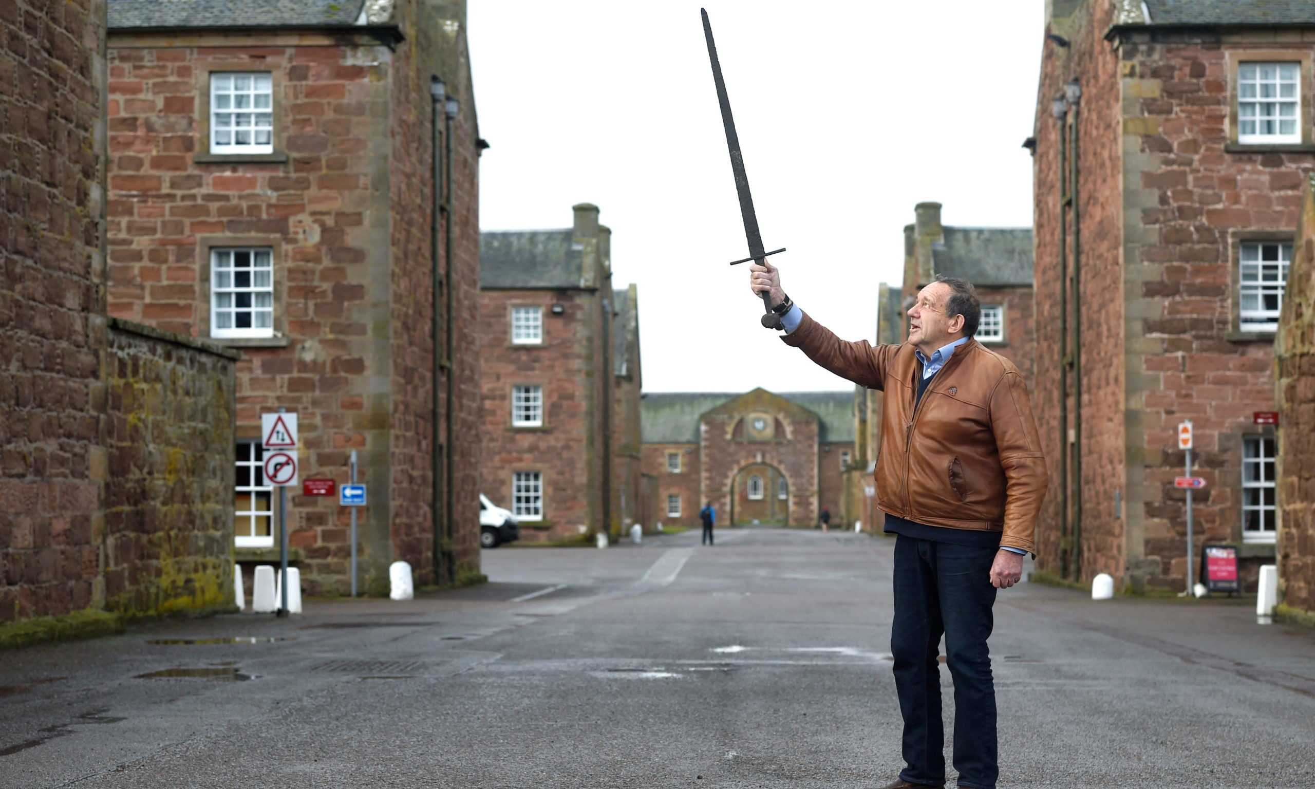 John Ormiston with his thirteenth century war sword reportedly recovered in 1876 from the site of the Battle of Stirling Bridge in Stirling when Wallace defeated the English. Picture by Sandy McCook