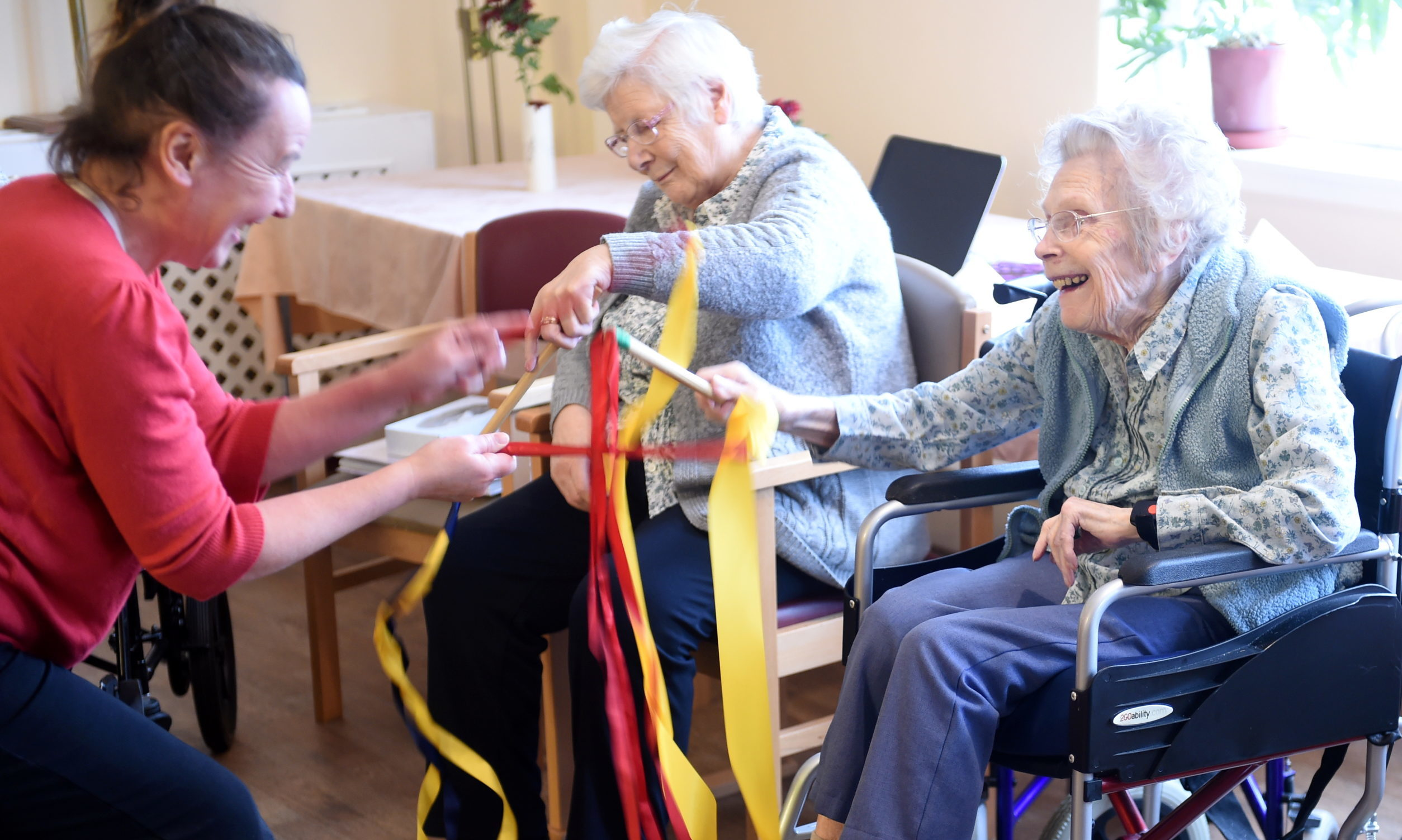 Residents of Whinnieknowe residential care home, Nairn enjoy exercise to dance music. Picture by Sandy McCook