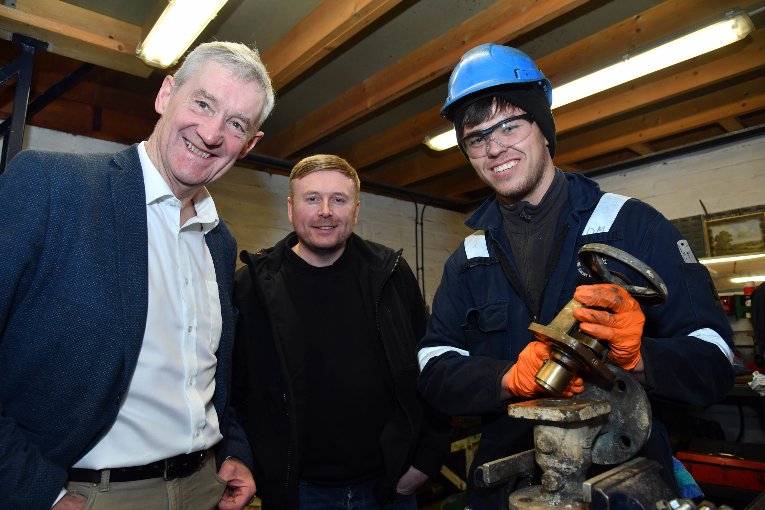 MSP Peter Chapman with apprentice engineer Daniel Mehigan and director Graeme Mackie during his visit to Bill Mackie Engineering LTD in Peterhead.