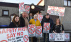 ST FERGUS VISITORS PROTESTING AGAINST PROPOSED WIND TURBINES NEAR THEIR VILLAGE