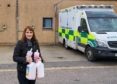 Irma Westwood, Deputy Head of Bishopmill Primary School, Elgin delivering the supplies of soap and towels.