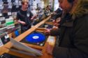 Photo by Stephen Chung/LNP/Shutterstock (10203276c) Customers listen to LPs in Phonica Records. Analogue music fans visit independent record shops in Soho to celebrate vinyl music on the 12th Record Store Day. Record store day, London, UK - 13 Apr 2019 Over 200 independent record shops across the UK come together annually to celebrate the unique culture of analogue music with special vinyl releases made exclusively for the day. In 2018, sales of vinyl rose for the 11th consecutive year to 4.2 million units according to the British Phonographic Industry (BPI).