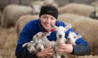 Emma Reid with the five healthy lambs.