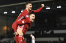 Aberdeen's Matty Kennedy and Mikey Devlin, right, after the win over St Mirren in Paisley.
