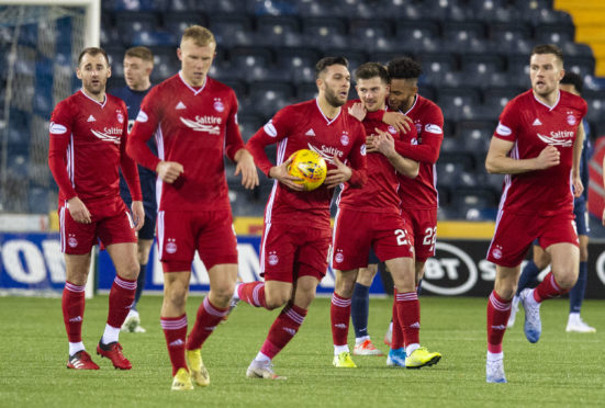 Aberdeen's players hurry to get play restarted after drawing level.