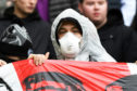A football fan with a face mask during the Ladbrokes Premiership match between Celtic and St Mirren at Celtic Park on March 7 as coronavirus concerns increased.