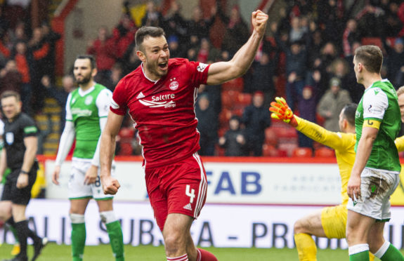 Andy Considine celebrates his goal which put Aberdeen 2-1 up against Hibs at the weekend.