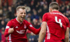 Aberdeen's Bruce Anderson (L) celebrates with goalscorer Andrew Considine during the Ladbrokes Premiership match between Aberdeen and Hibernian at Pittodrie Stadium