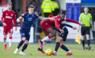 Ross County's Josh Mullin (L) and Marcus Fraser (R) are pictured in action with Rangers' Joe Aribo.