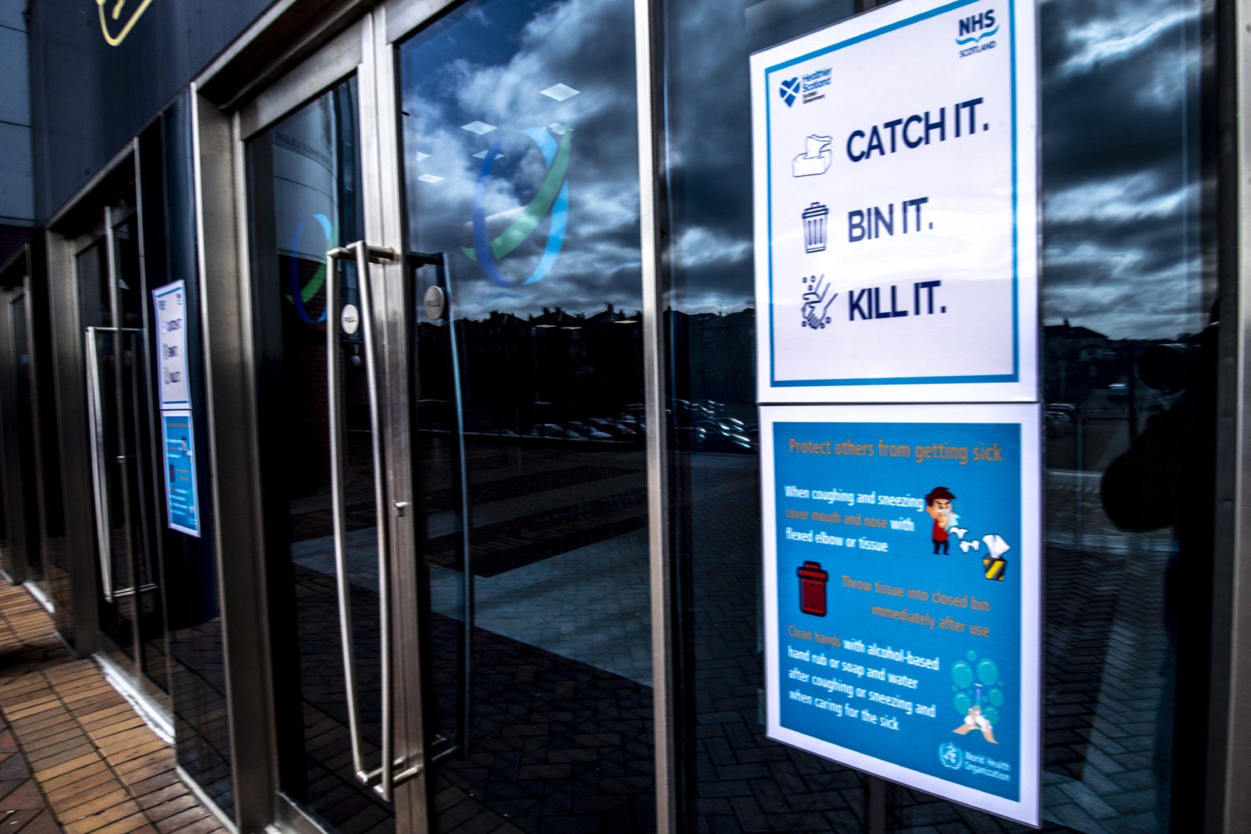 Coronavirus advice posters at Hampden Park.