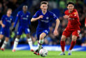 Chelsea's Billy Gilmour (centre) controls the ball away from Liverpool's Takumi Minamino (right) during an FA Cup fifth-round match at Stamford Bridge, London.