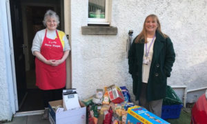 Theresa Bain, pictured right, delivers food to Hope Kitchen in Oban.