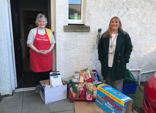 Theresa Bain delivering parcels to the Hope Kitchen.