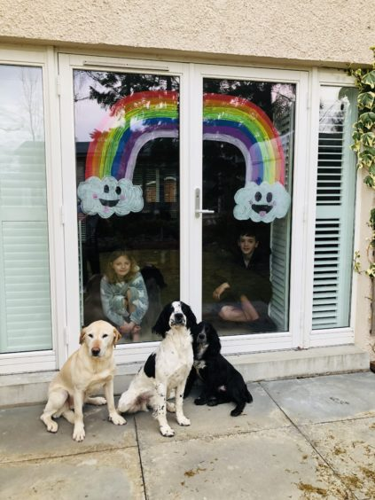Artists Jack(11) & Josie Esslemont(10) painted a rainbow on their patio window. They live in Aboyne.