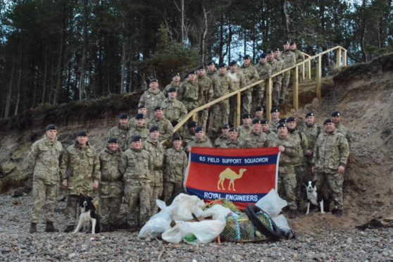 Personnel from 39 Engineer Regiment on the beach near Kinloss Barracks.