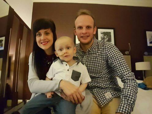 Hollie and Kris Dear with their son Hamish