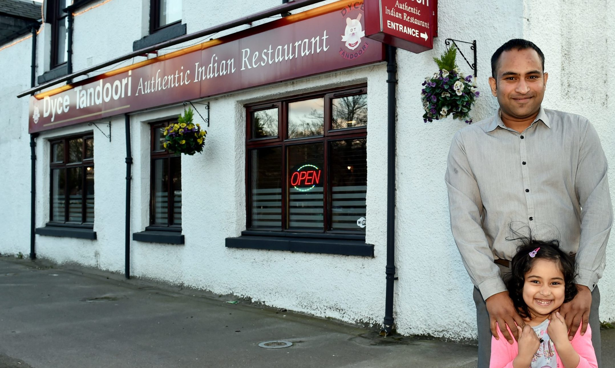 Nafiz Hasan with daughter Naureen, outside Dyce Tandoori. Picture by COLIN RENNIE