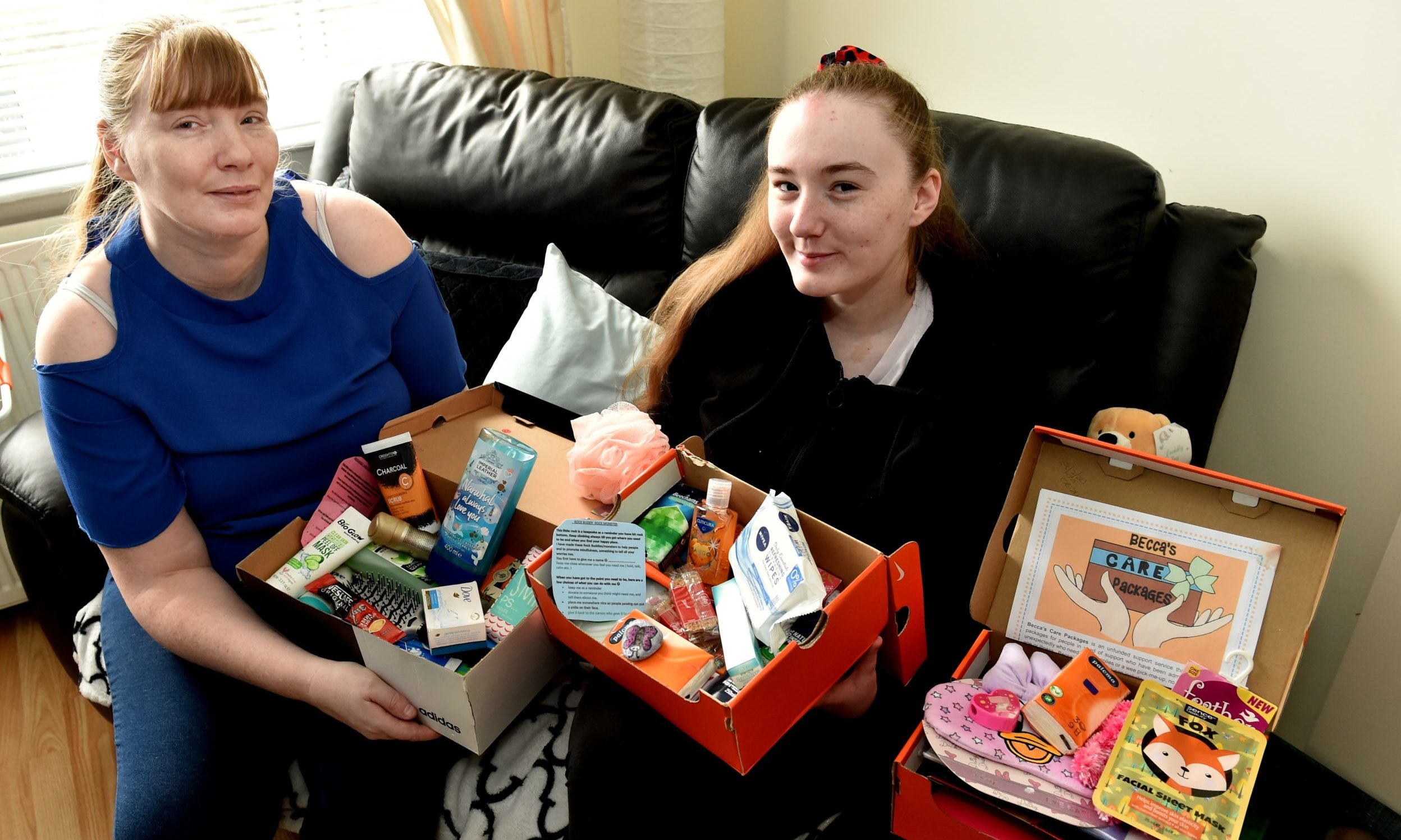 Becca Hammell delivers care packages with her mum Angela. Picture by Colin Rennie.