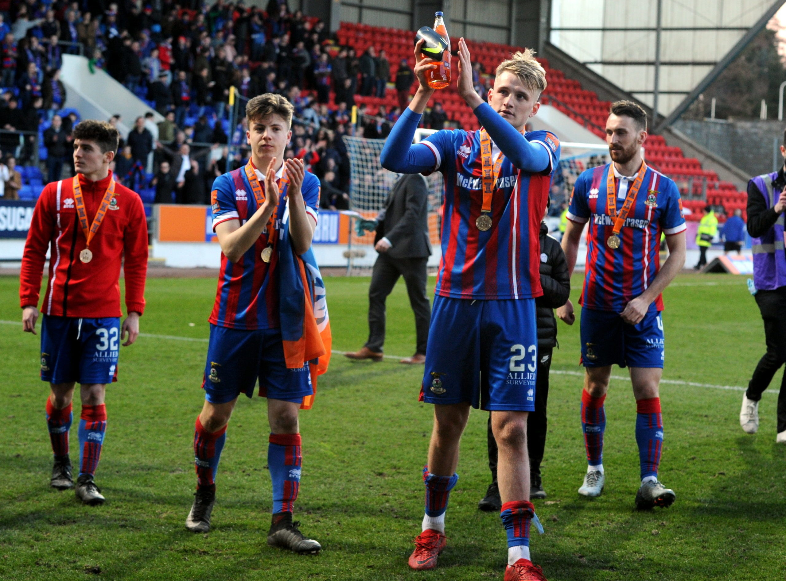 Daniel MacKay celebrates the Challenge Cup win with Coll Donaldson.