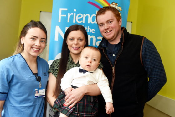 CR0020009 Alford mum Sarah Lawson meets with neonatal  nurse, Eilidh Ritchie who helped deliver her baby Harry. In the picture are from left: neonatal  nurse, Eilidh Ritchie, Mum, Sarah Lawson, baby Harry Smart and dad, Callum Smart at Maternity hospital, Aberdeen.