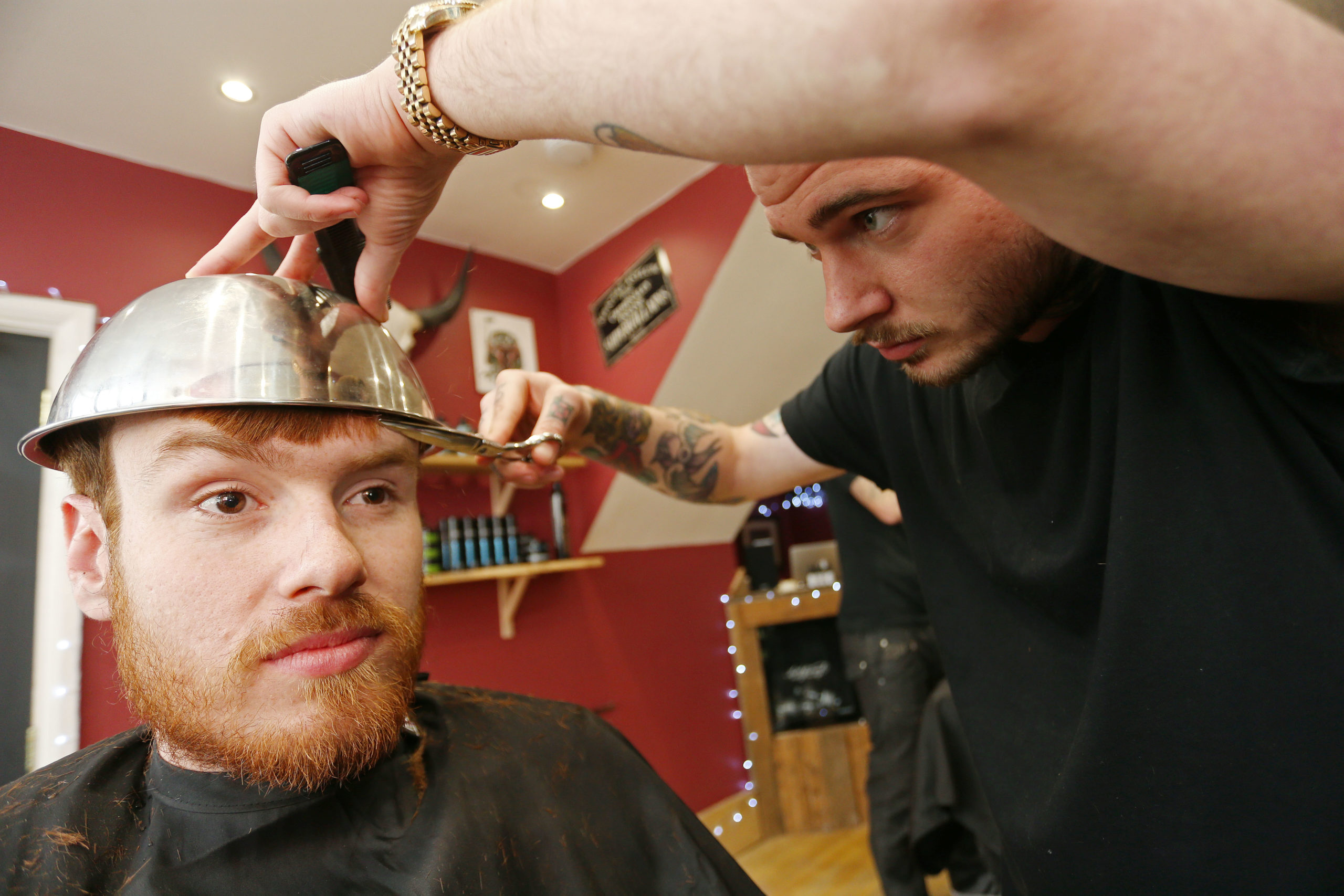 Photo by Joe Pepler/Shutterstock (4681781u) Customer gets the summer must-have style at Headcase Barbers Dumb and Dumber To - Bowl Cut Haircuts shoot, Richmond, London, Britain - 21 Apr 2015 Eager guys braved the 'bowl cut' trend, inspired by Jim Carey's character Lloyd Christmas in Dumb & Dumber To. Headcase Barbers has tipped the style as a must-have look for summer 2015. Dumb and Dumber To is out on Blu-ray and DVD now.