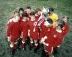Aberdeen players with the Tennent's Scottish Cup: (L-R) Henning Boel, Arthur Graham, Derek McKay, Jim Forrest, Tommy McMillan, Martin Buchan, Davie Robb, Jim Hermiston, Joe Harper, George Murray, Bobby Clark and George Buchan.