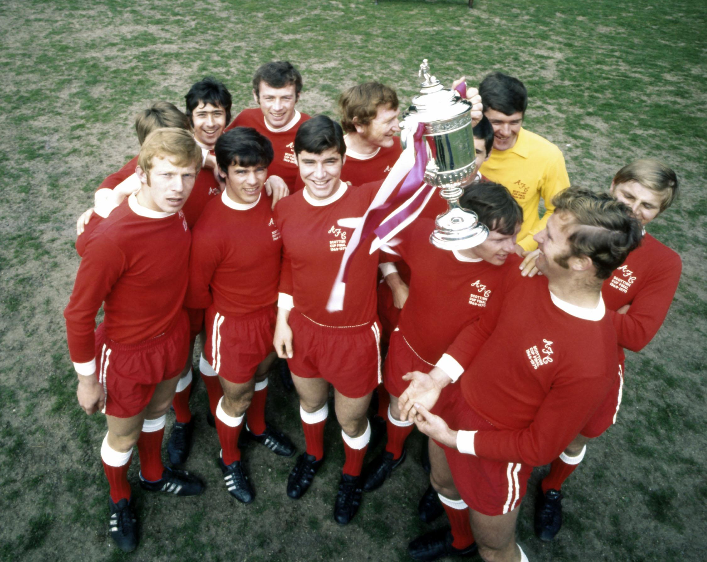 Aberdeen players with the Scottish Cup. From left, Henning Boel, Arthur Graham, Derek McKay, Jim Forrest, Tommy McMillan, Martin Buchan, Davie Robb, Jim Hermiston, Joe Harper, George Murray, Bobby Clark and George Buchan.