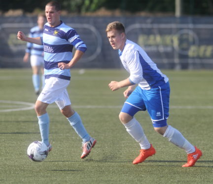 Golspie Sutherland's Craig Ross in action during a 2016 cup tie with Banks o'Dee.
