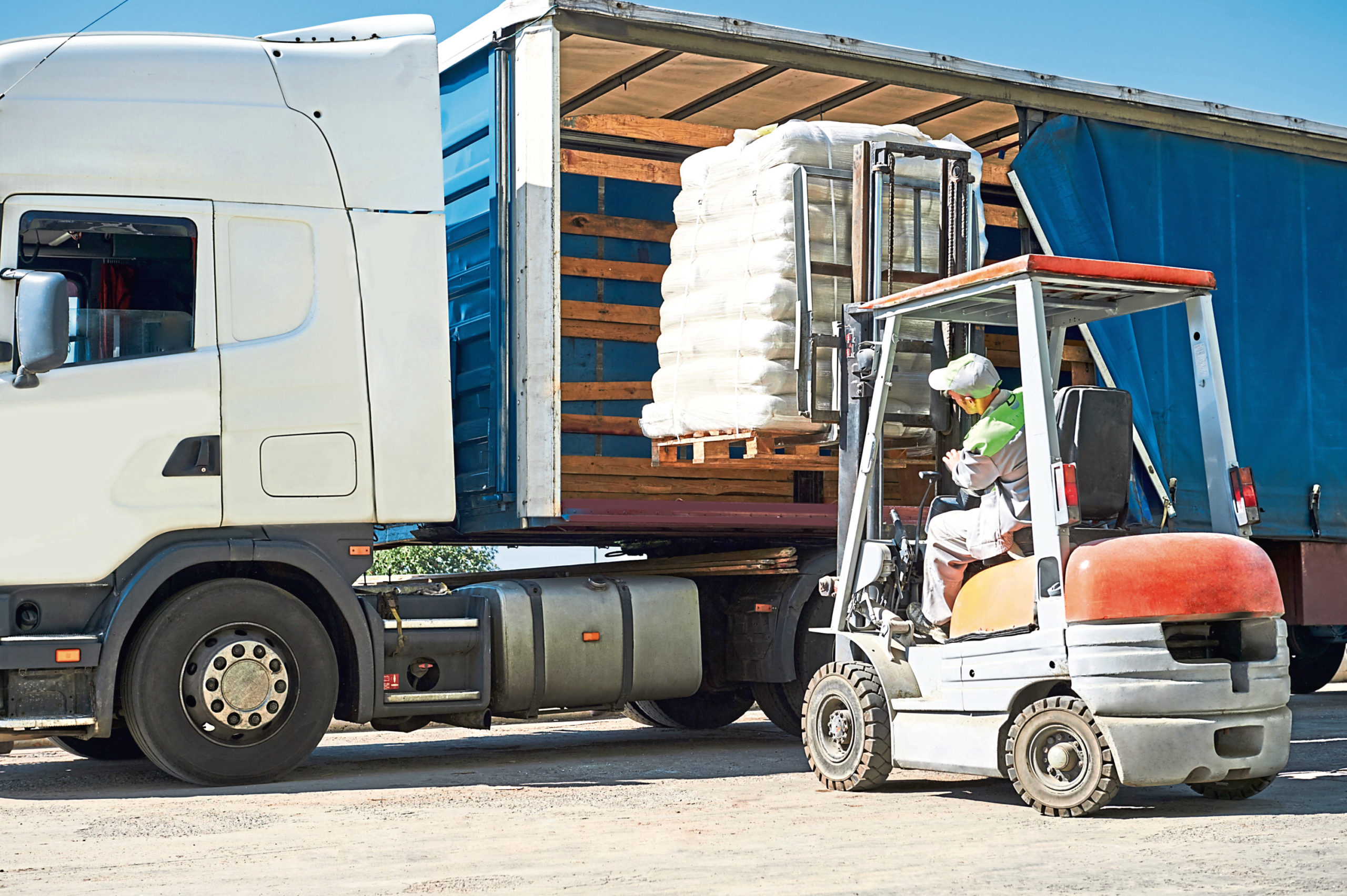 Farmers are being asked to keep a safe distance and provide hand sanitation for drivers delivering essential supplies.
