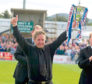 ICT manager John Robertson lifts the First Division trophy in 2004.