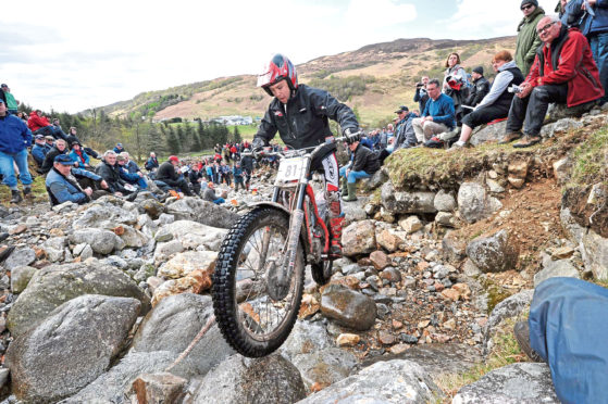 New reality: Spectators watch rider Gary MacDonald competing in one of the previous Six Day Trials annual motorcycle competitions