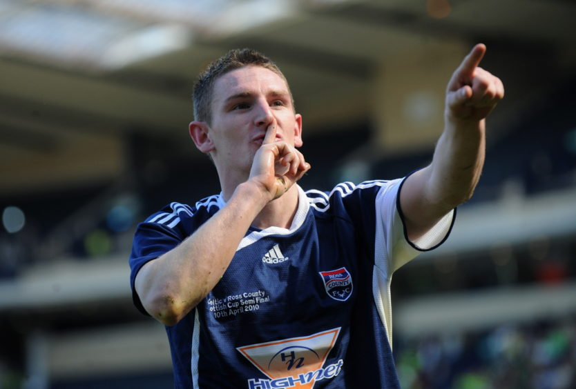 Martin Scott gestures to the crowd after scoring Ross County's second.