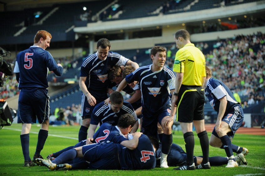 The Ross County players mob Martin Scott after he finished the tie