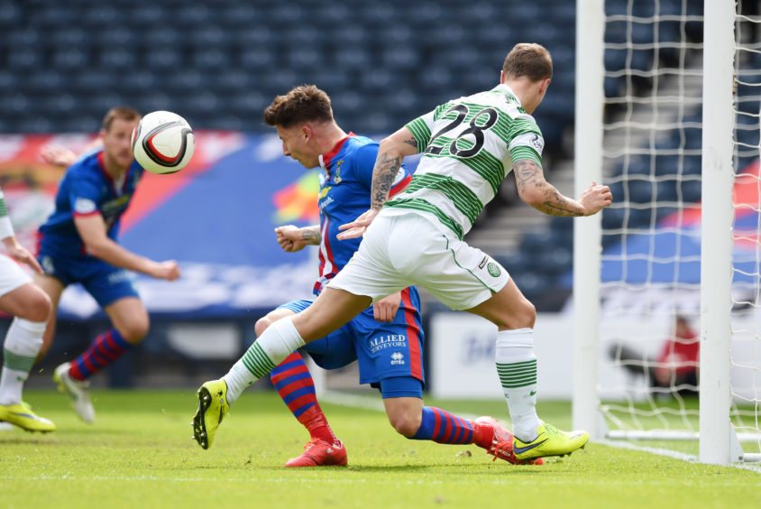 Celtic's Leigh Griffiths (right) sees his effort blocked by Josh Meekings. Meekings later admitted the ball struck his arm.